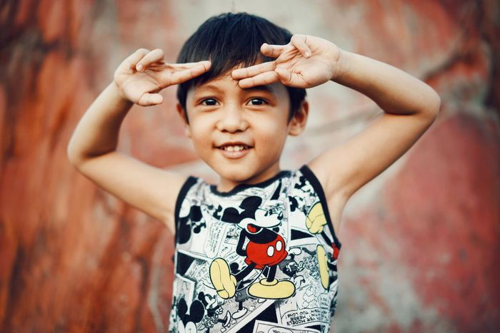 masculine pose Kidsphotography Kids Being Kids Kids EyeEmNewHere Playing Child Portrait Childhood Smiling Looking At Camera Girls Happiness Protruding Human Arm Arms Raised Preschooler Brown Eyes Making A Face Raised Eyebrows The Portraitist - 2018 EyeEm Awards