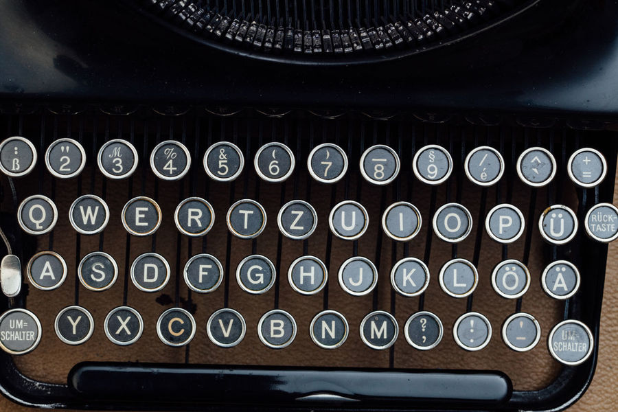 Vintage type writer on office desktop from above 1920s Analog Author Birds Eye View Classic Desktop From Above  High Angle View No People Office Old Type Writer Typewriter Typing Vintage Writing