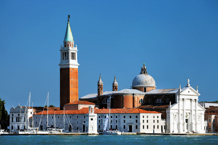 San giorgio maggiore by grand canal against clear blue sky