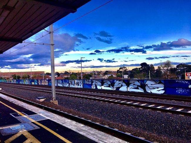 Beautiful evening sky from train station in western suburbs in Melbourne in chilling cold weather Railroad Track Rail Transportation Transportation Sky Cloud - Sky Railroad Station Railway Track Railroad Station Platform Day Blue Public Transportation Outdoors No People Built Structure Architecture Nature Nature Lover Daily Commute Local Transportation Grafiti Art Breathing Space Investing In Quality Of Life Your Ticket To Europe The Week On EyeEm EyeEmNewHere Your Ticket To Europe