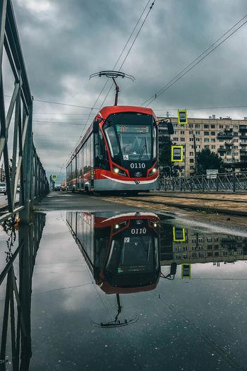 View of bridge in city during rainy season
