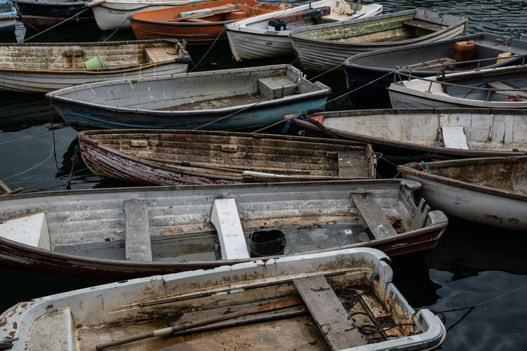 fishing boat collection in Mevagissey harbour Abandoned Day Fishing Fishing Boat High Angle View Large Group Of Objects Many Of A Kind Moored Nautical Vessel No People Old Rowboat Transportation Wood - Material