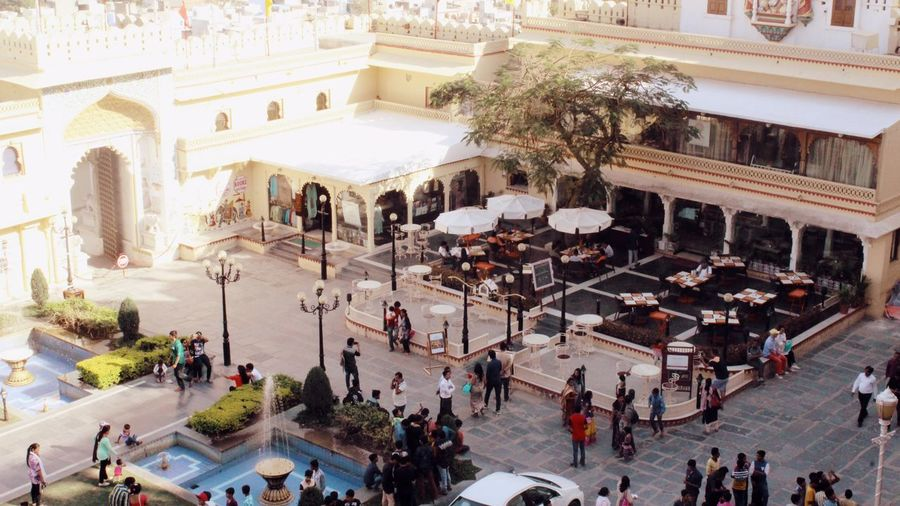 Open air restaurant within City Palace, Udaipur Adult Adults Only Architecture Building Exterior Built Structure City Day Group Of People High Angle View Large Group Of People Lifestyles Men Outdoors People Real People Tree Walking Women