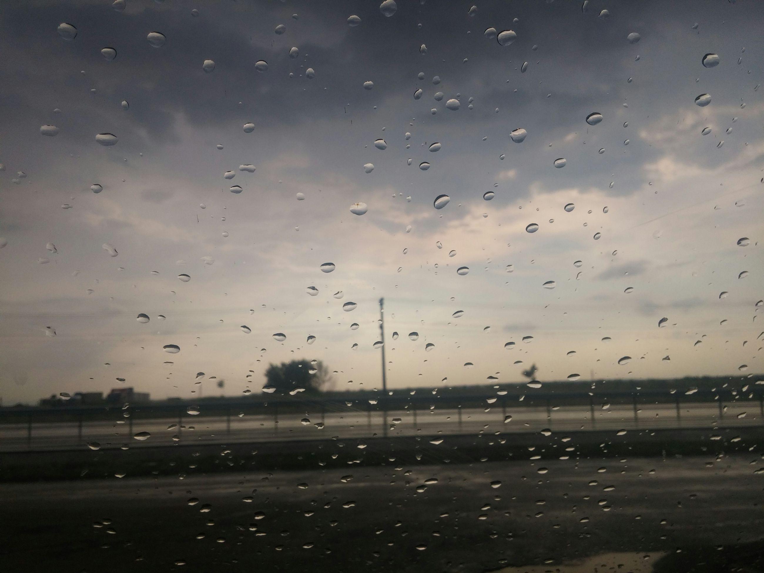 drop, wet, rain, sky, water, window, weather, raindrop, transparent, glass - material, indoors, dusk, cloud - sky, silhouette, glass, monsoon, season, nature, overcast, focus on foreground