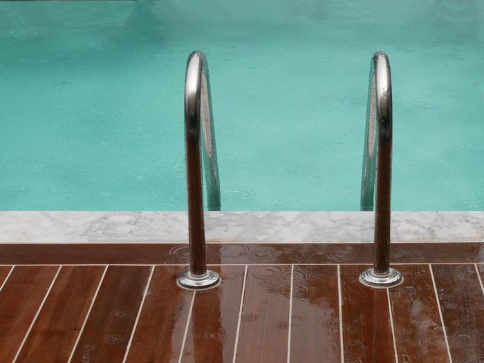 RainyDays Pooldeck Decking Teak Wood Metal No People Wood - Material Water Day High Angle View Nature Wall - Building Feature Outdoors Close-up Security Architecture Protection Swimming Pool Pole Still Life Safety Flooring
