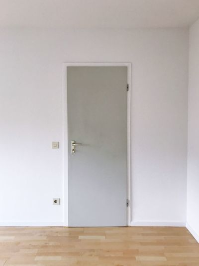 Closed wooden door at home