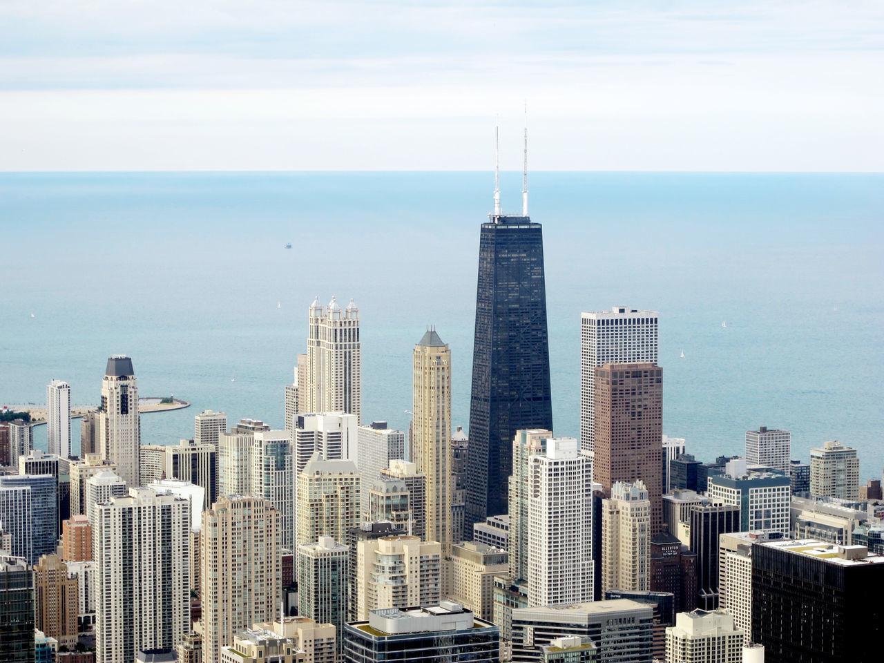 High Angle Shot Of Cityscape Against Calm Sea