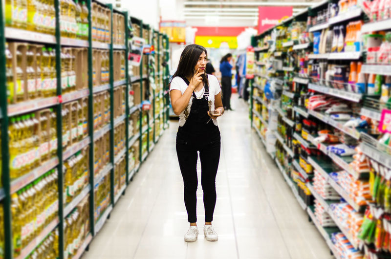 Full length of woman shopping in supermarket
