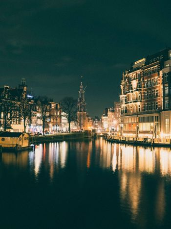 Amsterdamcity Amsterdam EyeEm Selects Building Exterior Night Built Structure Architecture Reflection Illuminated No People City Water Sky Waterfront Travel Destinations Cityscape