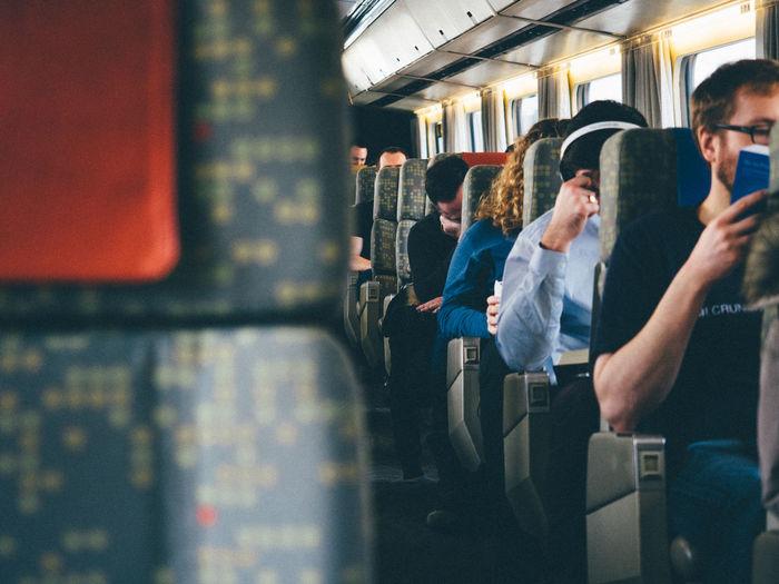 Train ride home for Christmas Commuter Mode Of Transport Passenger Public Transportation Railroad Car Rush Hour Subway Subway Train Train - Vehicle Transportation Travel Traveling Home For The Holidays Vehicle Interior