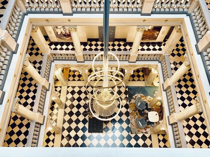 High Angle View Architecture No People Staircase Indoors  Steps And Staircases Pattern Railing Built Structure Metal Flooring Design Spiral Day Wood - Material Building Tile Sunlight Tiled Floor Tray Hotel Ritz-Carlton Hotel Ritz-Carlton Genf Genfersee Geneve Geneva Lobby Lobby View