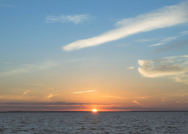 Beauty In Nature Cloud - Sky Horizon Horizon Over Water Idyllic Nature No People Non-urban Scene Orange Color Outdoors Scenics - Nature Sea Sky Sun Sunset Tranquil Scene Tranquility Water Waterfront