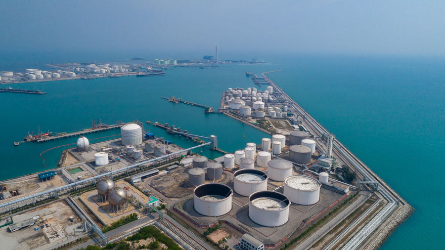 Aerial view oil view at oil refinery plant form industry zone with sunrise and cloudy refinery