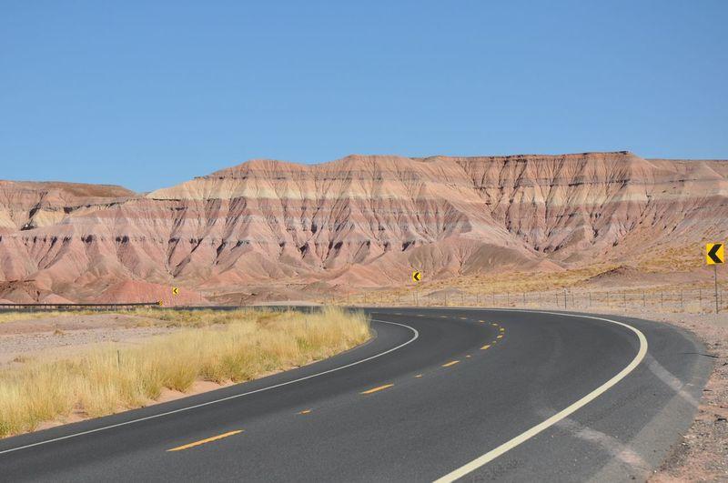 Empty Road Along Rocky Landscape