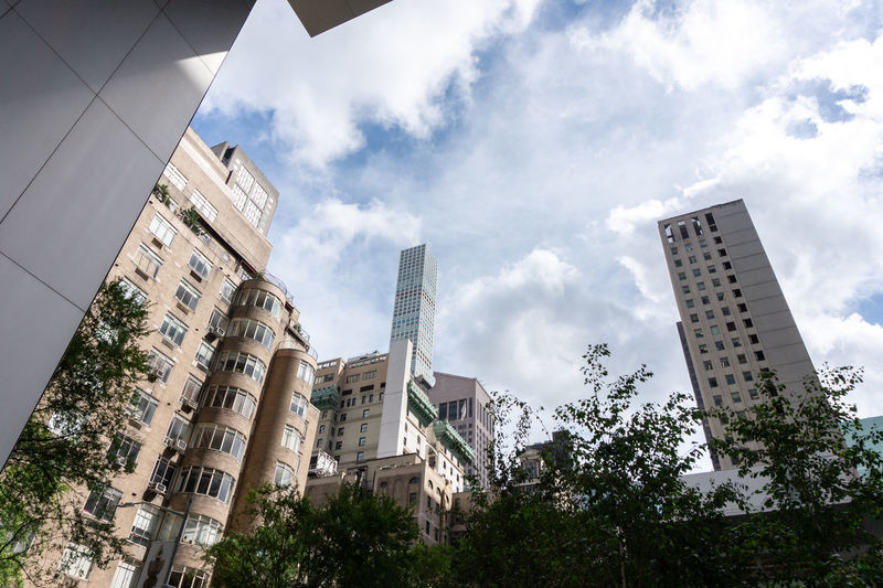 Building Exterior Built Structure Architecture Low Angle View Building Sky Tree Cloud - Sky Plant No People Day City Nature Residential District Outdoors Office Building Exterior Office Skyscraper New York New York City Big City Life USA Moma Modern Museum Of Modern Art