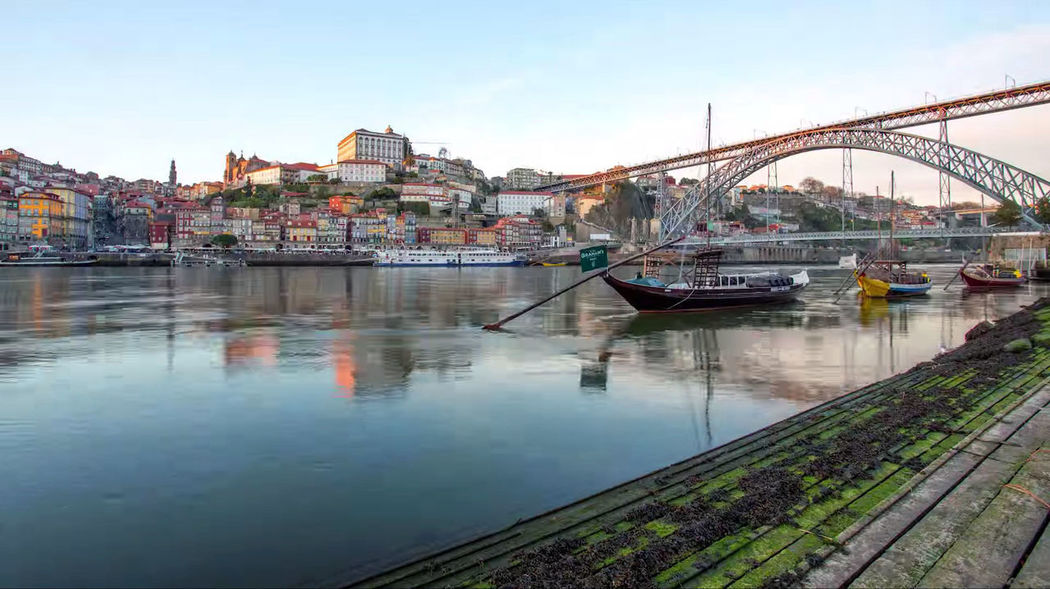 Perspectives from Porto. Transportation Architecture Built Structure Water Building Exterior Nautical Vessel Bridge Mode Of Transportation Bridge - Man Made Structure Sky Connection River City Nature Travel Building Residential District Reflection No People Outdoors Passenger Craft Arch Bridge Beauty In Nature Beautiful Nature