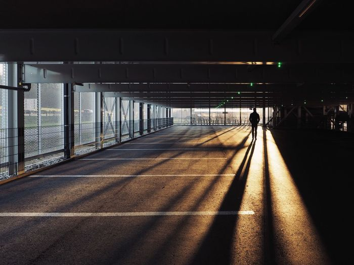 The Way Forward Lifestyles Real People Architecture Day Light And Shadow Parking Sunrise Sunrise Silhouette Urban Landscape Urban Urban Geometry Warm Light Long Shadows at Basel, Switzerland Welcome To Black The Secret Spaces The Architect - 2017 EyeEm Awards EyeEm Ready
