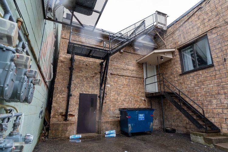 Garbage bin against buildings