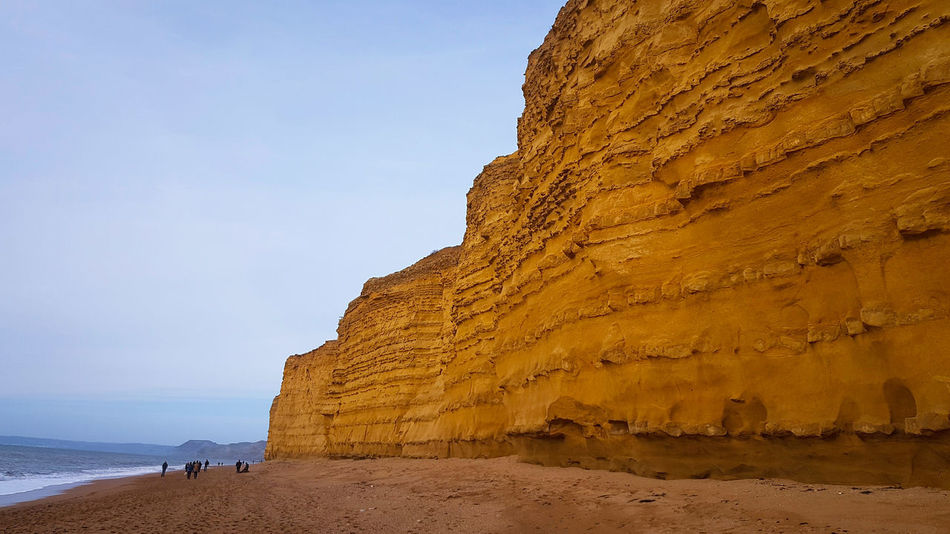 Rock - Object Travel Destinations Tourism Beach Travel Outdoors Sea Nature Fossil Vacations Sand Cluff Beauty In Nature No People Landscape Day Rock Face