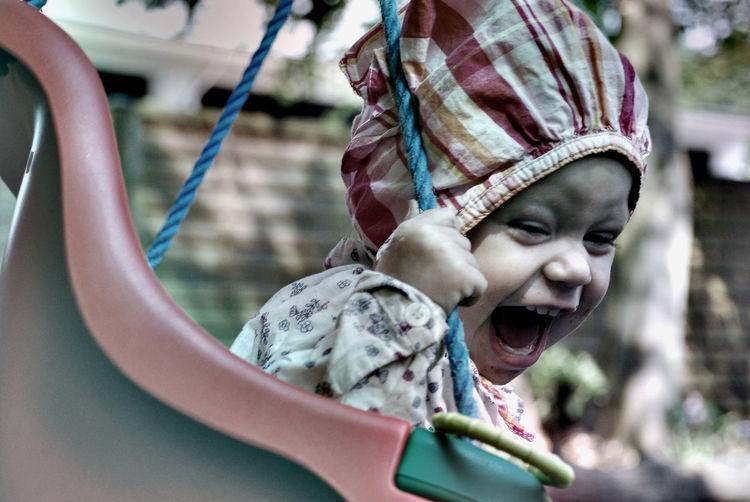 Close-up of baby enjoying on swing