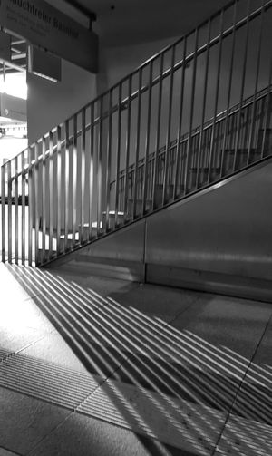AntiM From A Train Patterns Everywhere Stairs & Shadows Architecture Blackandwhite Built Structure Ceiling Corridor Day Empty Flooring Illuminated Indoors  Light And Shadow Modern No People Railing Staircase Stairs_collection Stairways Südkreuz Train Station The Street Photographer - 2018 EyeEm Awards
