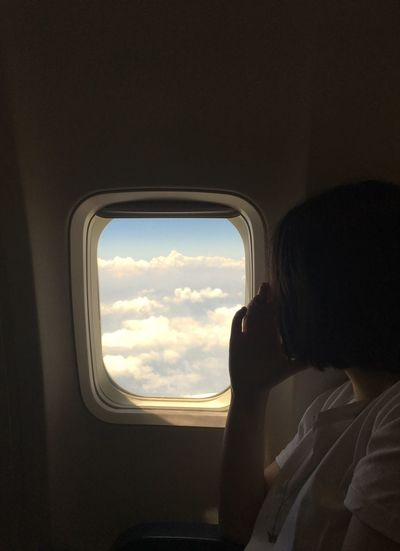 Traveling Window One Person Real People Vehicle Interior Mode Of Transportation Transportation Travel Looking Lifestyles Leisure Activity Airplane Air Vehicle Looking Through Window Sky Cloud - Sky Headshot Women It's About The Journey