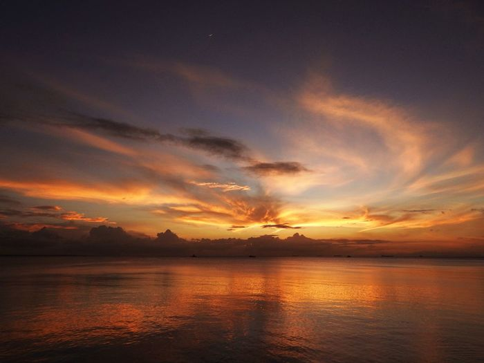 Sunset Sunset Sky Water Cloud - Sky Tranquility Beauty In Nature Sea Scenics - Nature Tranquil Scene Reflection Orange Color Nature Idyllic No People Dramatic Sky Atmospheric Mood Dusk Environment Horizon Over Water Romantic Sky