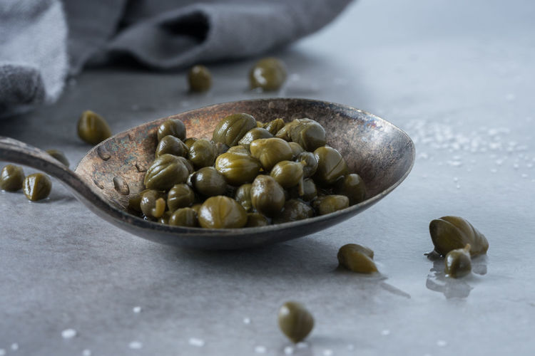 A spoonful of capers Berries Caper Food And Drink Isolated Pickled Spoon Bud Capers Close-up Food Healthy Eating Ingredient Kitchen Utensil No People Seasoning Spoon Spoonful