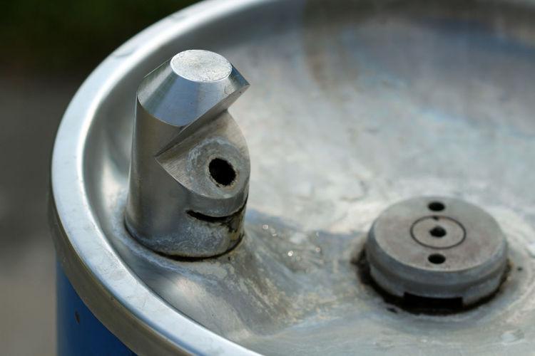 Close-up of metallic drinking fountain