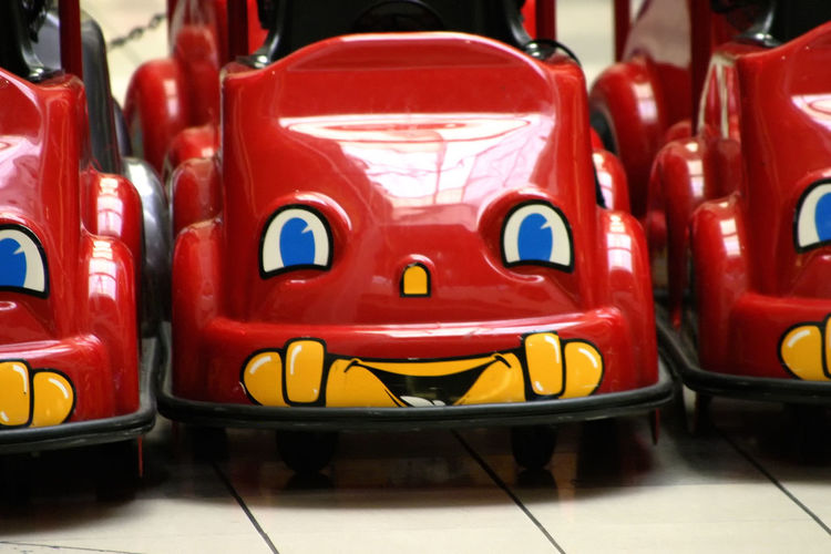 Kiddie Cars Red Toy Cars Close-up Day Face On Car Indoors  No People Pedal Cars Red Toy Cars EyeEm Ready   Mobility In Mega Cities