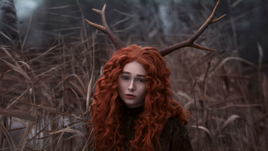 Portrait Of Young Redhead Woman In Forest