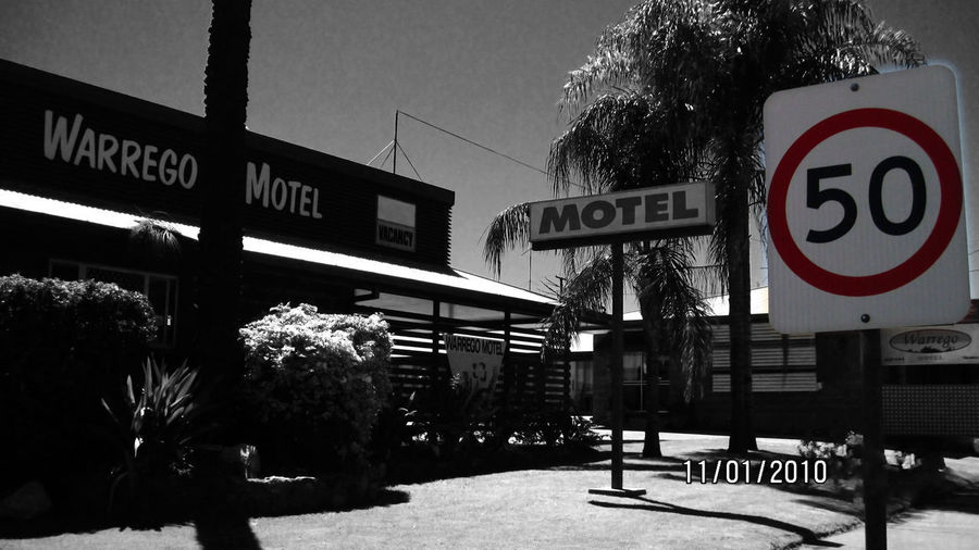 holiday motel :- 50 0 photos on the Market ✌ Australian Motel Color Sign Restriction Panel Warrego Motel Black And White And Color Frontage Panorama View Palm Trunk Text 50 Speed Sign Text Fifty Panels Motel Trees Lawn Sunny Black And White Palms Australia & Travel Edited Retro Photography 16x9 Photography 2010 In Charleville, Queensland Australia