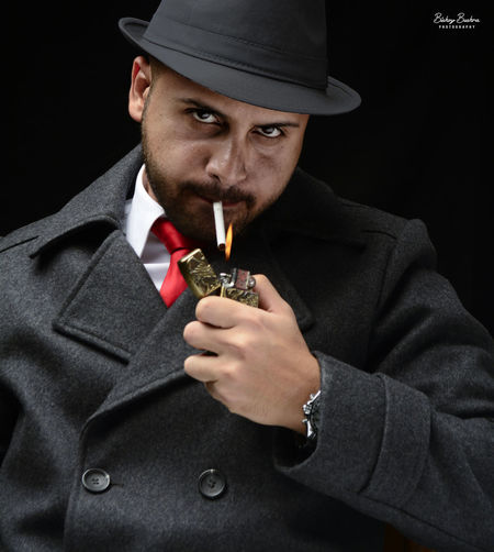 Mafia Portrait Adult EyeEmNewHere Fashion Flame Black Background Cigarette Lighter Close-up Coat Gangster Hat Headshot Indoors  Killer Men One Person People Photography Portrait Serious Seriuous Face Smoking - Activity Smoking Issues Studio Shot Suit