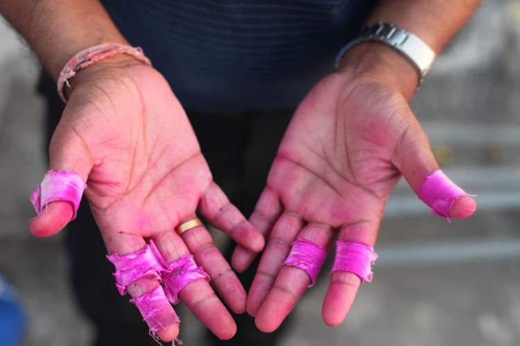 Manual worker showing stained hands