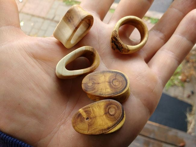 Handmade Mulberry and Cherry wood ear gauges and Mulberry ring. Close-up Human Hand Wood Wood Jewelry Ear Gauges Gauge Ring Mulberry Cherry Wood Plugs Popular Jewelry Wood - Material Woodworking Handmade Gauges Eye4photography  Canada Coast To Coast Eyeem Collection Handmade For You