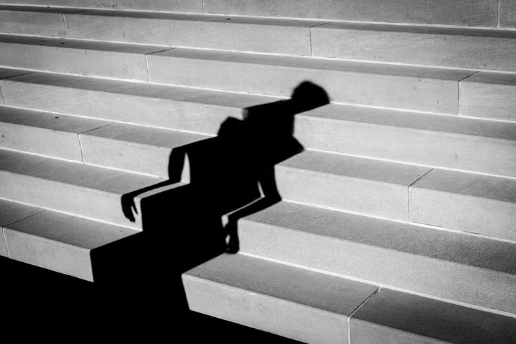 Shadow of person on staircase