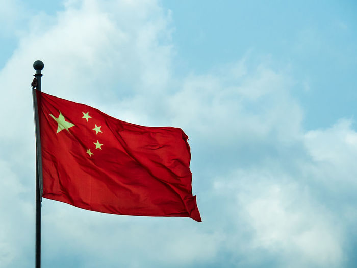 Low angle view of chinese flag against sky