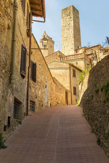 A high tower in San Gimignano, Italy. San Gimignano Tuscany Alley Architecture Building Building Exterior Built Structure City Day Diminishing Perspective Direction Footpath History Italy Nature No People Old Outdoors Residential District Sky Street The Past The Way Forward Wall