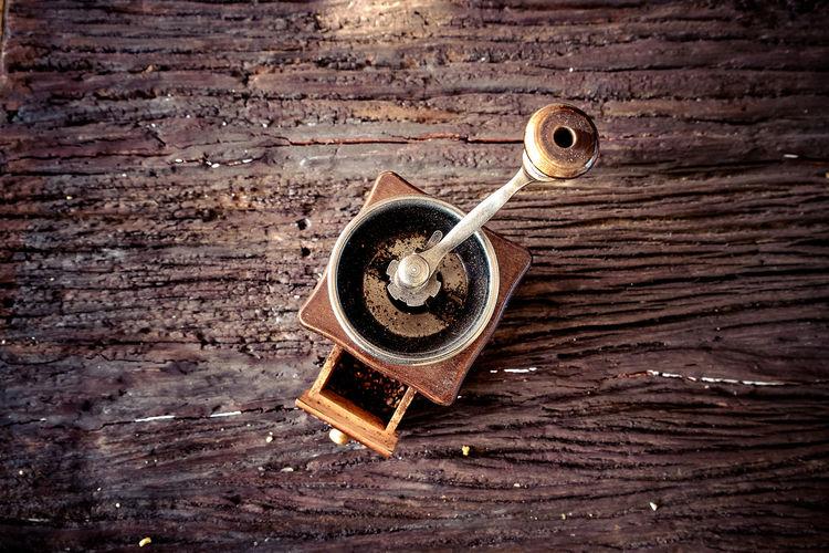 High angle view of key on wood