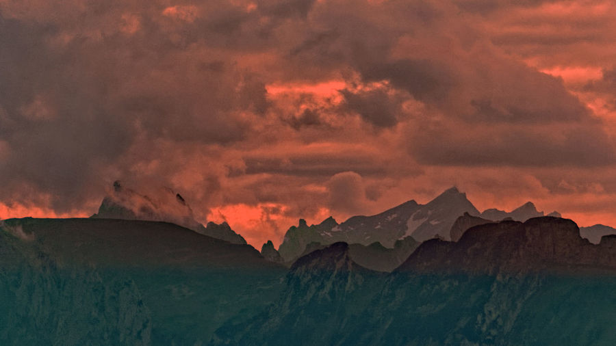 Cloud - Sky Sky Scenics - Nature Mountain Beauty In Nature Sunset Tranquil Scene Tranquility Nature No People Idyllic Landscape Environment Non-urban Scene Orange Color Cold Temperature Mountain Range Dramatic Sky Geology Mountain Peak Formation