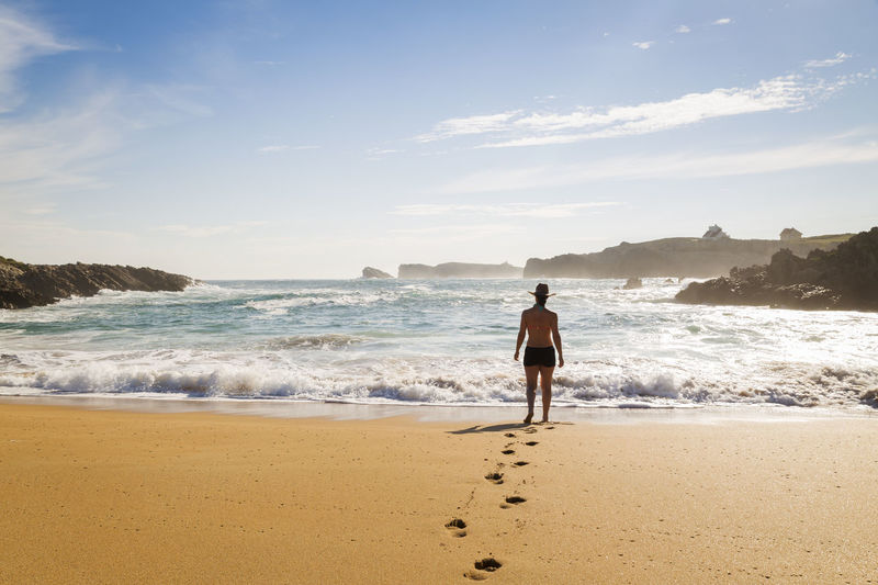 Woman walking on the sand of a beautiful beach