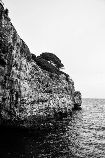 Black & White Beauty In Nature Black And White Cliff Copy Space Day Eroded Land Monchrome Nature No People Outdoors Portrait Seascape Rock Rock - Object Rock Formation Scenics - Nature Sea Seascape Sky Solid Stack Rock Tranquil Scene Tranquility Water