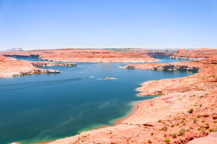 America; Area; Arizona; Blue; Boat; Canyon; Clear; Clouds; Color; Colorado; Dam; Desert; Destination; Famous; Glen; Holiday; Lake; Landmark; Landscape; Marina; Marine; Mountains; Nation; National; Nature; Navajo; Orange; Outdoor; Page; Park; Powell; Recre Beauty In Nature Blue Clear Sky Day Mountain Nature No People Outdoors Scenics Sea Sky Tranquil Scene Tranquility Water