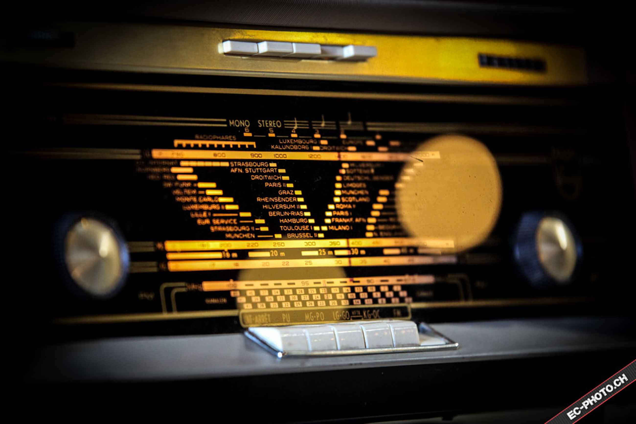transportation, car, communication, text, land vehicle, western script, mode of transport, technology, indoors, close-up, number, speedometer, no people, control, car interior, illuminated, old-fashioned, yellow, dashboard, retro styled