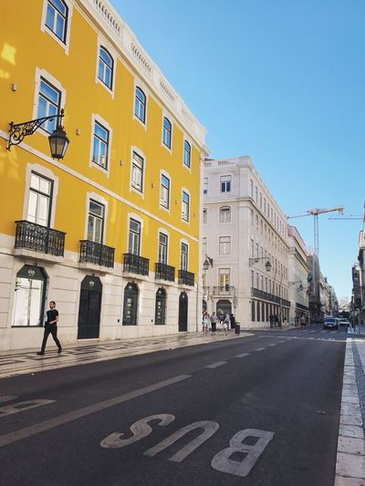 View of road in city against clear sky