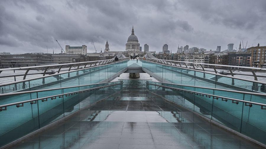 Footbridge over buildings in city
