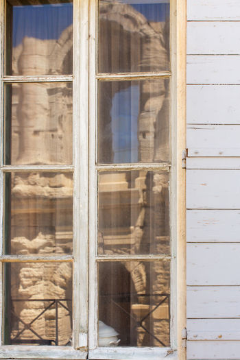 Window reflection of the Arles Amphitheatre Architecture Building Exterior Built Structure Close-up Day Full Frame Glass Glass - Material Historic Outdoors Reflection Stone Material Tourism Transparent Travel Destinations Window Window Frame