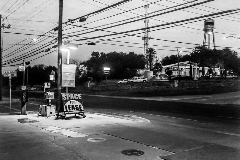 Austin Texas Exotic Dancer Gas Station No People Outdoors Power Lines Street Water Tower