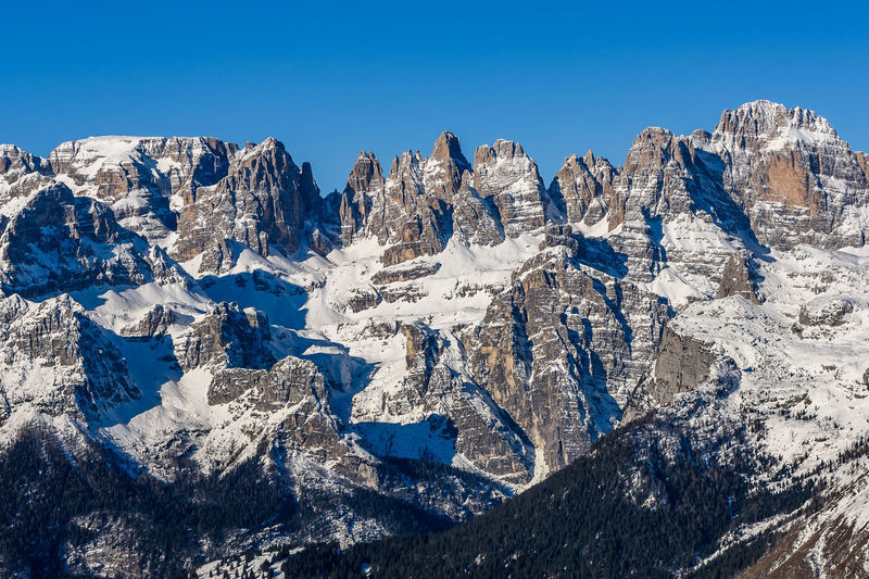 Brenta Dolomites Dolomites, Italy Trentino Alto Adige Andalo Beauty In Nature Blue Clear Sky Cold Temperature Day Landscape Mountain Mountain Range Nature No People Outdoors Scenics Sky Snow Snowcapped Mountain Tranquil Scene Tranquility Winter