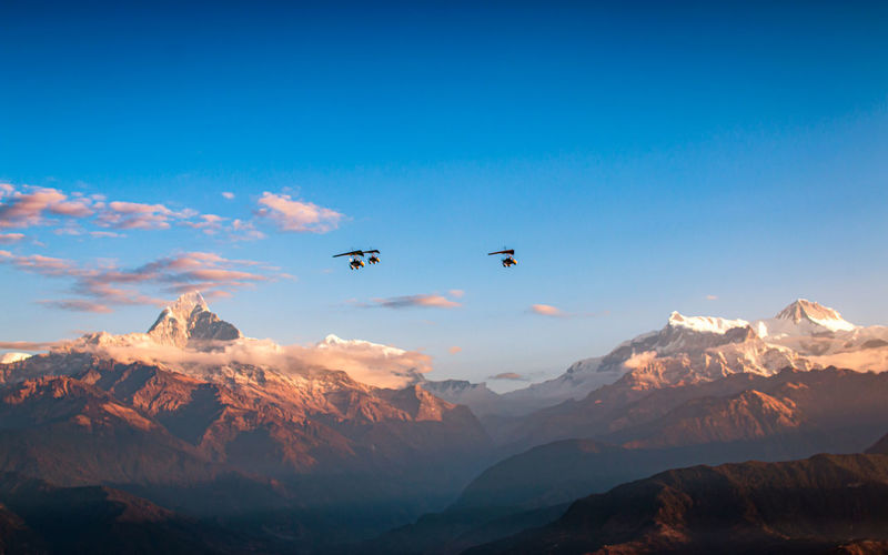 Flying ultralight aircraft over the mount annapurna rang at pokhara, nepal